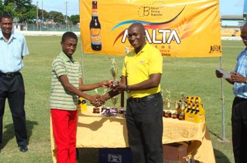 ADRIAN HINDS RECEIVING HIS BEST BATSMAN TROPHY IN THE BANKS DIH MALTA SUPREME U-13 COMPETITION 2014-15