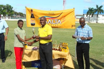 ADRIAN HINDS RECEIVING HIS MVP TROPHY IN THE BANKS DIH MALTA SUPREME U-13 COMPETITION 2014-15