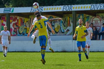 Jack Wightwick and Tyler Johal contesting a header.