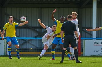 Carlton Town players appealing for a penalty.