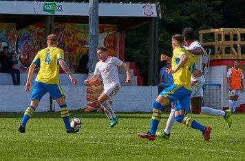 Harry Millard running at the defence.