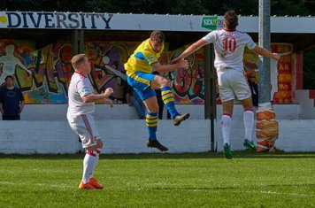 Toby Moore and Harry Millard jumping for the ball.