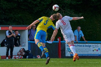 Toby Moore and Danny North contesting a header.