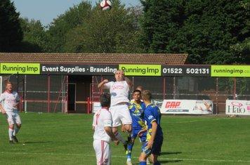 Scott Matthews jumping for a header.
