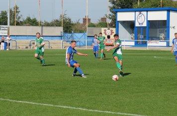 Harry Millard passing forwards.