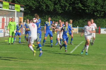Jack Wightwick and Lewis Brownhill contesting a header.