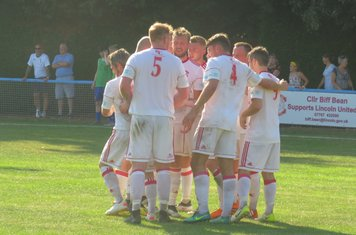 Danny North being congratulated for scoring.