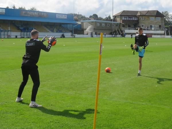 Michael Emery and Ollie Battersby warming up.