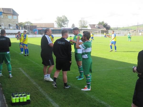 Players having a drink during a stoppage.