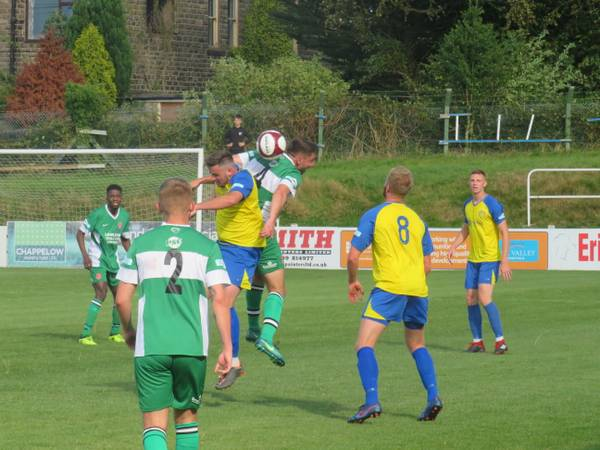 Scott Ruthven and Harry Millard contesting a header.