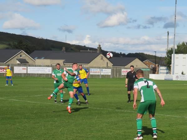 Noel Burdett heading the ball.