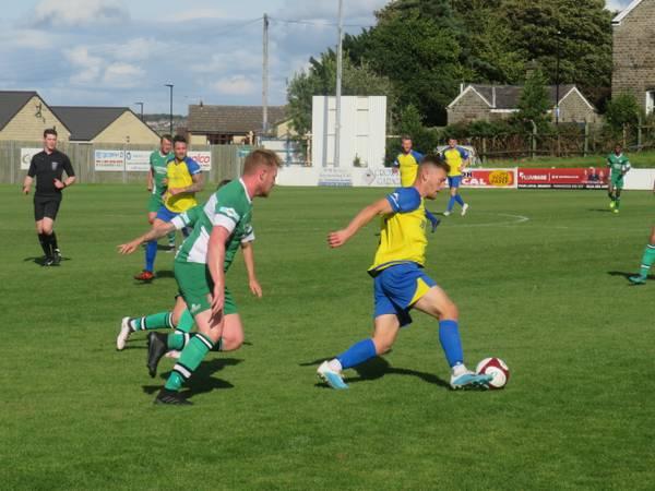 Luke Mangham holding the ball up.