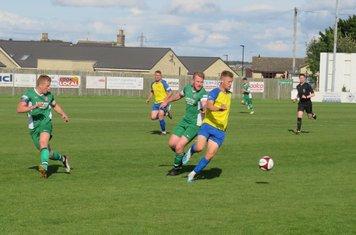 Luke Mangham under pressure from Mark Gray.