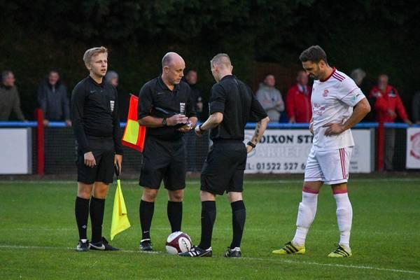 Matt Wilson and the officials before kick off.