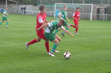 Jack Turnbull under pressure from Nick Parker.