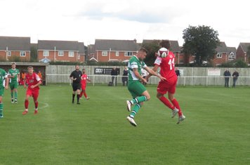 Jack Turnbull winning a header.