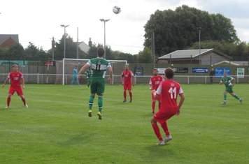 Jack Wightwick heading the ball.