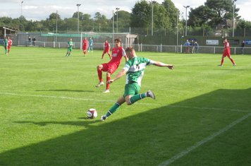 Jack Turnbull sending a long ball forward.