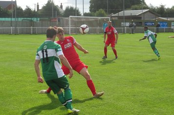 Jack Wightwick dinking a ball over the defence.