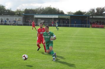 Noel Burdett passing the ball.
