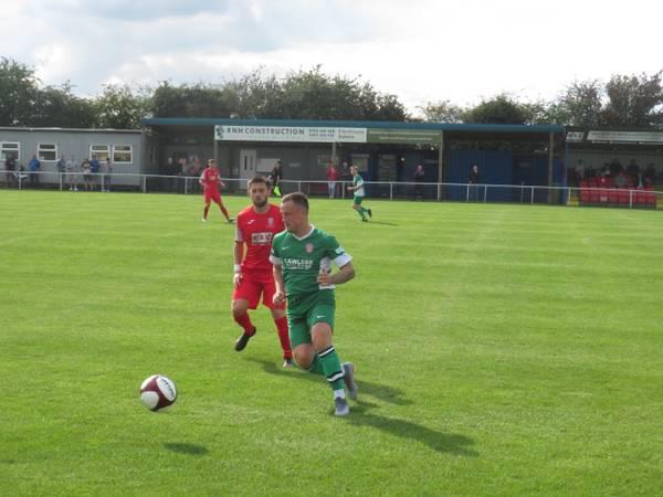 Noel Burdett passing the ball.
