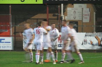 Jamie Goddard being congratulated for scoring.