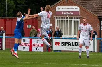 Ryan Horne and Jamie Goddard going up for a header.