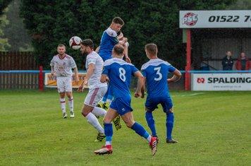 Matt Wilson in action for Lincoln United.