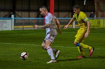 Noel Burdett dribbling forwards.