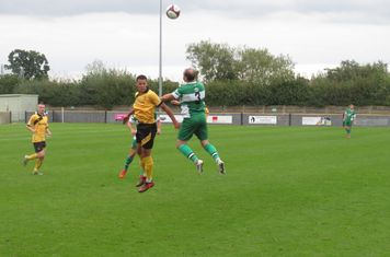 Scott Matthews winning a header.