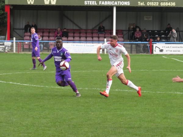 Kingsley Adu-Gyamfi and Harry Millard in action.
