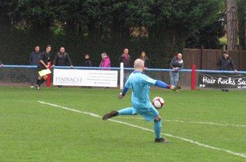 Tom Nicholson punting the ball forward.