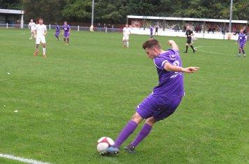 Alex Morris sending a long ball forward.