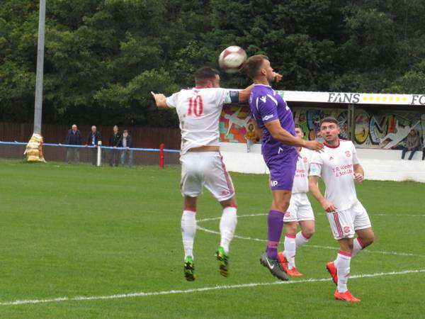 Matt Wilson winning a header.