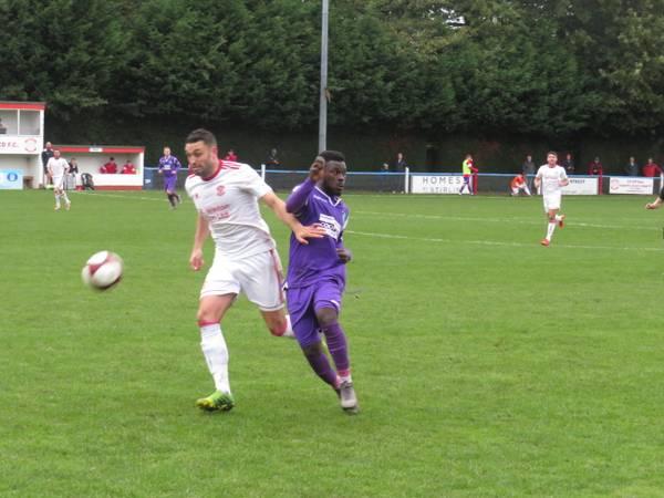 Matt Wilson and Kingsley Adu-Gyamfi running for the ball.