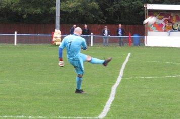 Tom Nicholson punting the ball upfield.