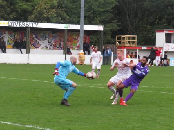 Tom Nicholson reaching for the ball.
