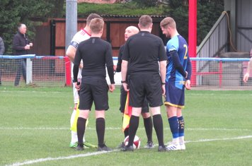 Captains and officials before kick off.