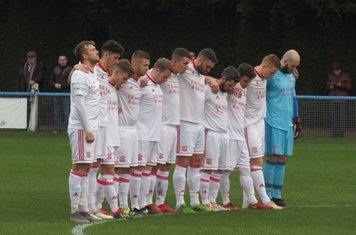 Lincoln United observing a minute's silence.