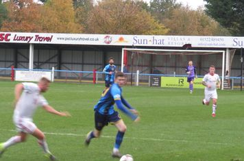 Jack Turnbull and Jamie Walker racing for the ball.