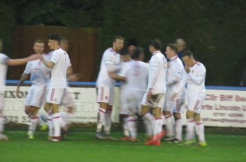 Jack Wightwick being congratulated for his second goal.