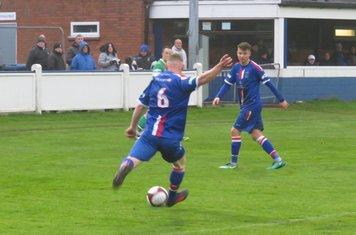 William Whieldon sending a long ball forward.