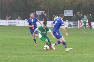 Jack Wightwick running at the defence.