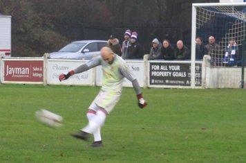Tom Nicholson taking a free kick.