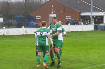 Danny North being congratulated for his goal.