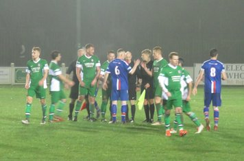 Handshakes at full time.