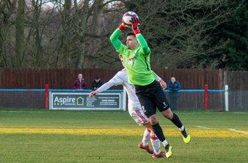 Theo Richardson catching the ball.