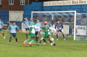Elliot Wilson shielding the ball.