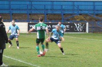Harry Millard on the ball.