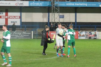 Tiernan Brooks being congratulated for his penalty saves.